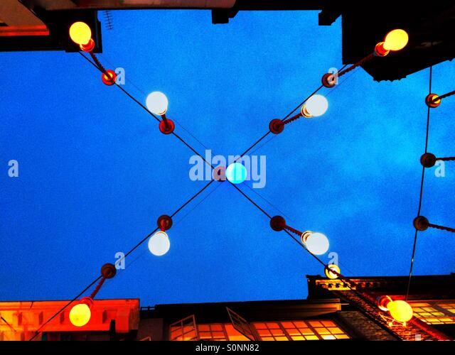 red white blue christmas lights over a street in london uk stock image - Red White And Blue Christmas Lights