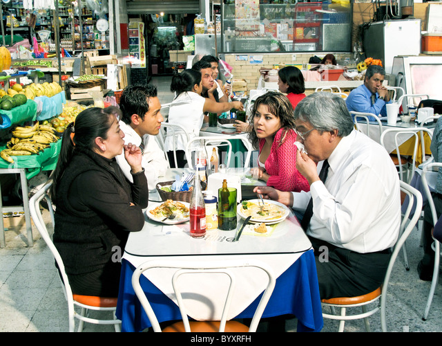 Mexican Diners Enjoy Plates Of Hearty Simple Food In Bright Colorful Restaurant Area Medellin Market Roma