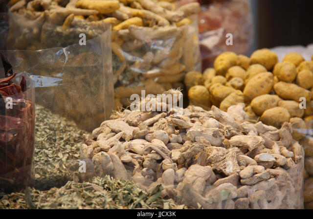 Exotic Spices kept for sale in huge bags in an Arabian market - Stock Image