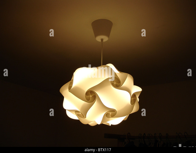 Hanging Lamp Shade: Designer lampshade suspended from ceiling with light on - Stock Image,Lighting