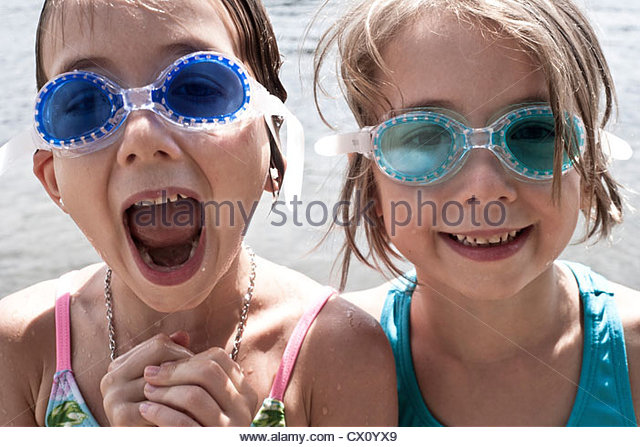 girls goggles wjzi  Two girls wearing swimming goggles