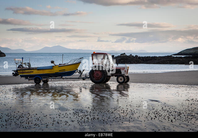 Tractor Pull Boats : Tractor towing boat stock photos
