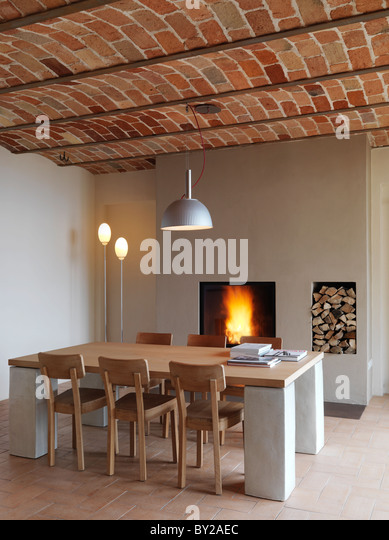 Modern Table With Six Wooden Chairs In Front Of A Fireplace Terracotta Tiled