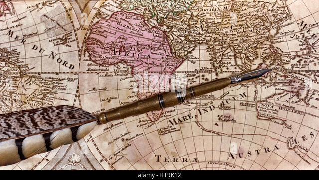 Pen on old world map stock photos pen on old world map stock quill pen laying on old world map with quill pen stock image sciox Gallery