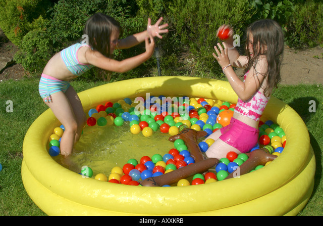 Paddling pool garden girl stock photos paddling pool for Garden paddling pools