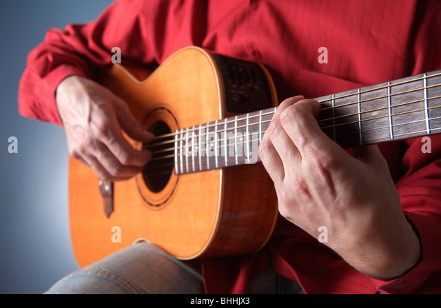 Close Up Hands Playing Acoustic Guitar Stock Photos ...