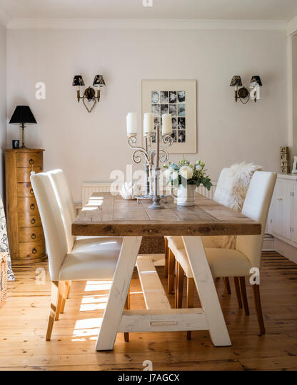Airy Dining Room With Large Wooden Table And Wooden Flooring. The Dining  Chairs Are From