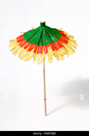 A Colourful Cocktail Umbrella On White Background   Stock Image