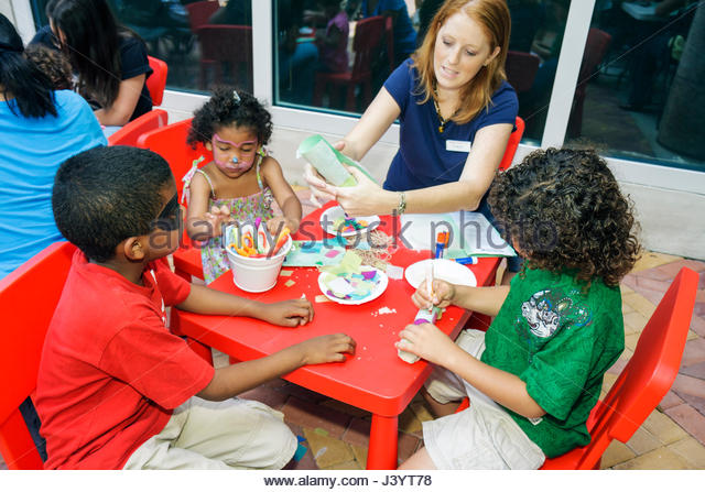 Miami Florida Adrienne Arsht Performing Arts Center centre Family Fest Hispanic woman girl boy child volunteer arts - Stock Image