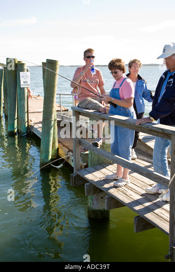Mother son on beach fishing stock photos mother son on for Fishing docks near me