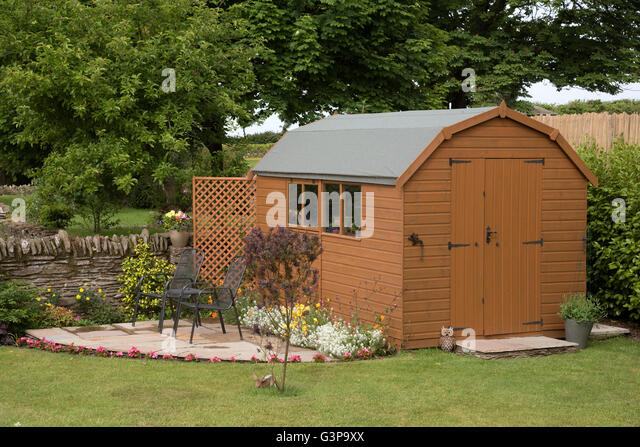 devon england uk a barn style garden shed with a small patio and chairs stock - Garden Sheds With Patio