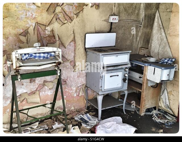 1950u0027s Kitchen Appliances In An Abandoned Farm Cottage.   Stock Image