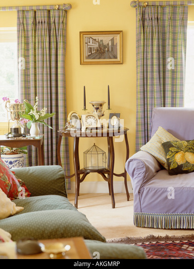 Green Sofa And Mauve Armchair In Pastel Yellow Living Room With Mauve And  Yellow Checked Curtains Part 68
