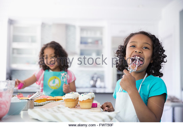 Woman Decorating Cupcakes licking icing stock photos & licking icing stock images - alamy