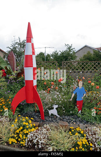 comic character inspired garden furniture here of tintin and a rocket in a small