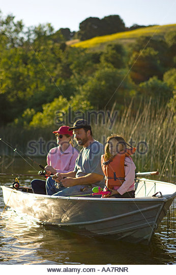Family fishing rowboat stock photos family fishing for Family fishing boats