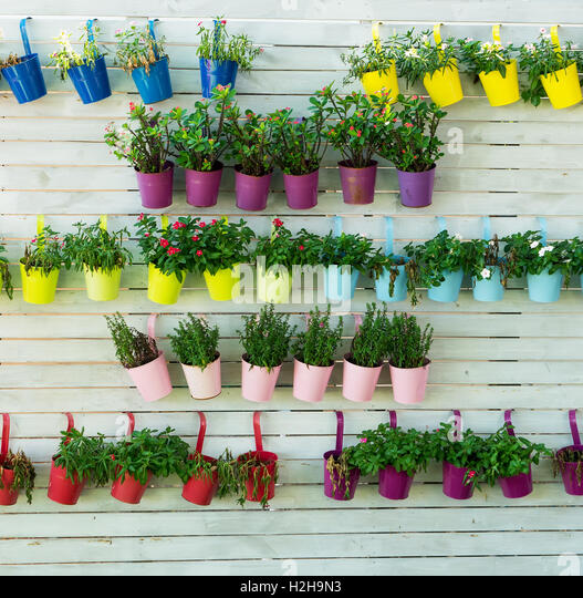 Hanging flower pots fence stock photos hanging flower for Fence hanging flower pots
