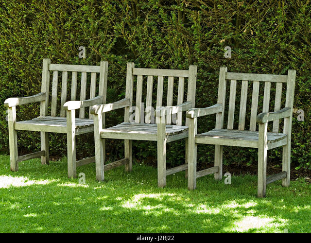 Row of three wooden garden chairs  Barnsdale Gardens  Oakham  Rutland   England. Chairs Garden Furniture Seating Stock Photos   Chairs Garden