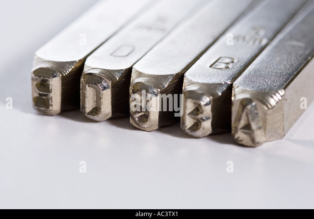 Indentifying stock photos indentifying stock images alamy for Punch letters into metal
