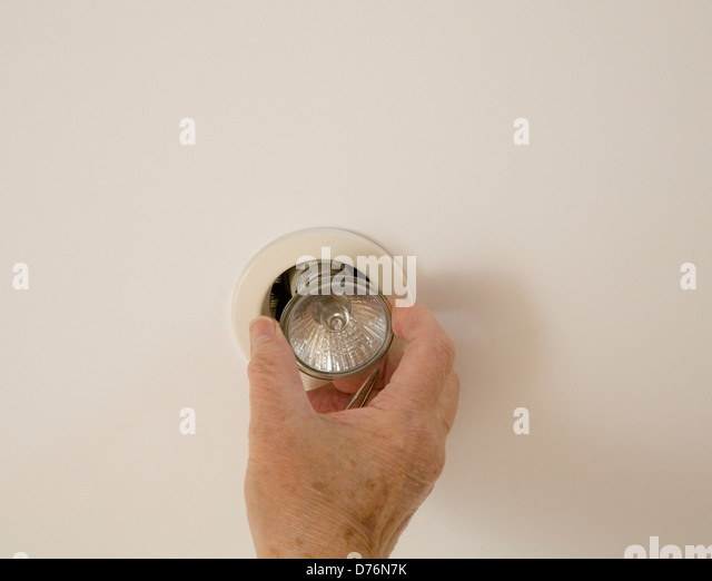 Changing light bulb stock photos changing light bulb stock uk elderly woman changing a ceiling light bulb stock image mozeypictures Gallery