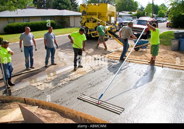 Cement truck stock photos cement truck stock images alamy for How to pour a concrete driveway