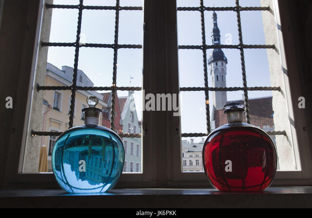 Estonia, Tallinn, Old Town, Raekoja Plats, Town Hall Square, Town Council Pharmacy, b. 1422, colored liquid in window - Stock Image