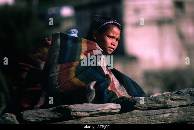 http://l7.alamy.com/zooms/35dc1a8a8dae4027b4ecb1c87ae97794/tibetan-girl-wrapped-in-blanket-jharkot-annapurna-area-nepal-atbjec.jpg