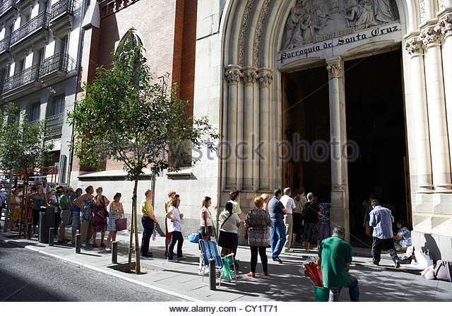 People Queuing And Waiting To Go Into Church In Madrid Spain
