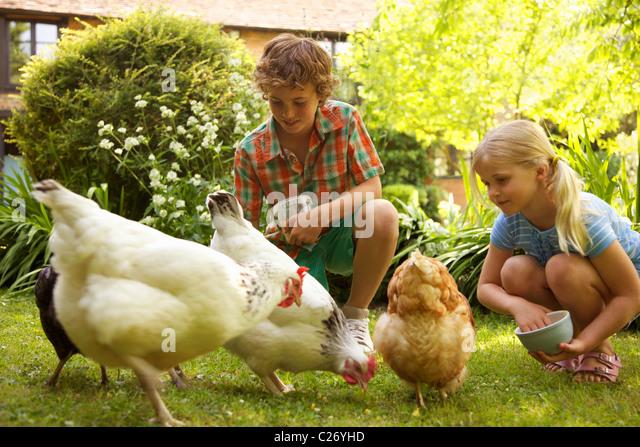Family Farm Children Animal Stock Photos & Family Farm ...