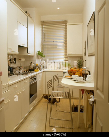 Galley Kitchen With Breakfast Bar breakfast bar stool stock photos & breakfast bar stool stock