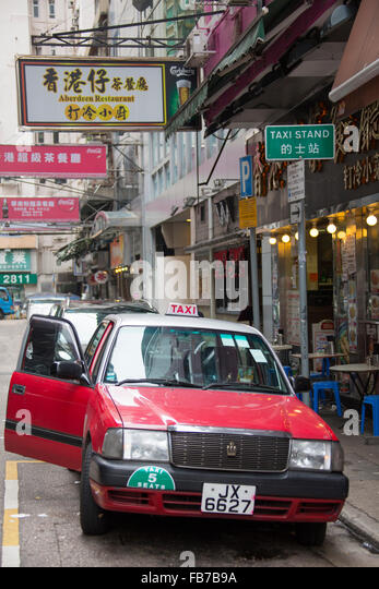 Red Urban Taxi Picking A Client In Hong Kong