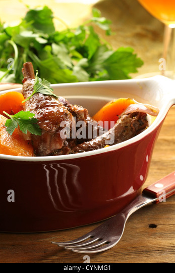 Traditional French cuisine - chicken in wine, coq au vin - Stock Image