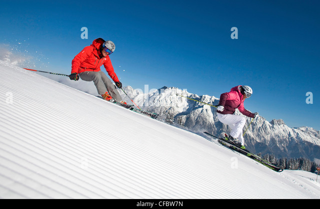 Austria carving ski skiing sport winter woman stock photos