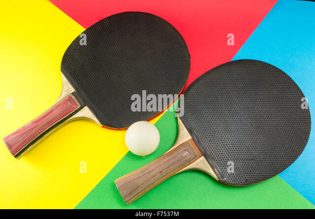 pair of table tennis paddles on a colorful collage background stock image