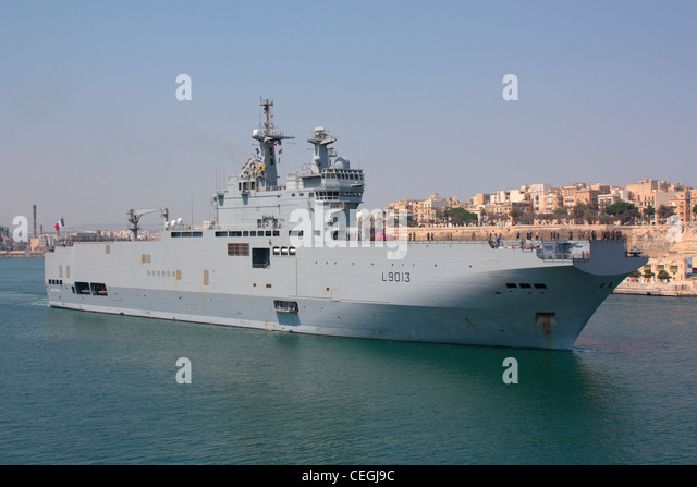 the french navy assault ship mistral departing from malta after a break from operations off libya