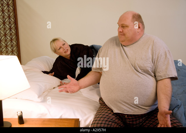 Fat couple couch stock photos fat couple couch stock for Couch you can sleep on