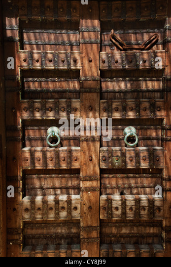 Balinese style large wooden carved doors in Bali Indonesia with metal door knockers and studs. & Wooden Balinese Doors Stock Photos \u0026 Wooden Balinese Doors Stock ... Pezcame.Com
