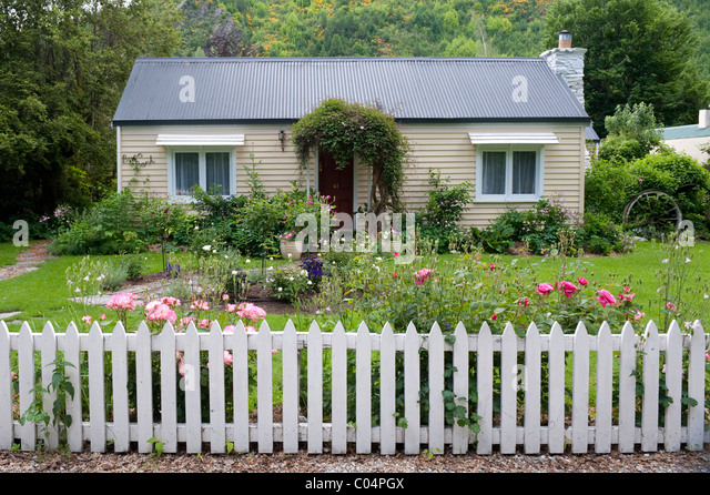 A Simple Weather Boarded Bungalow With Rose Garden And White Picket Fence  At Arrowtown, New