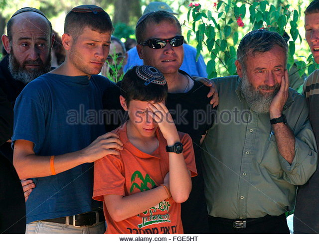 The reburial funeral ceremony for his older son israeli stock image