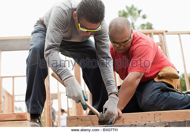 Construction Workers Working On A House