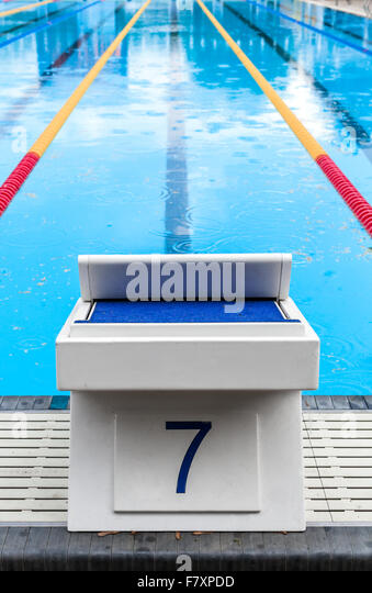 olympic pool start block with the lucky seven number stock image