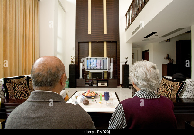 Old Couple In Modern Villa Old Couple With Big Tv Screen Living Stock Photo Picture And