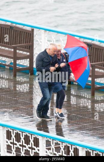Wet Windy Umbrella Stock Photos & Wet Windy Umbrella Stock ...