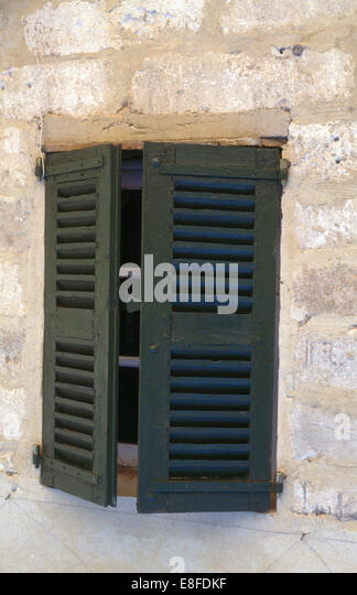 Wooden shutters window stock photos wooden shutters for Country shutters