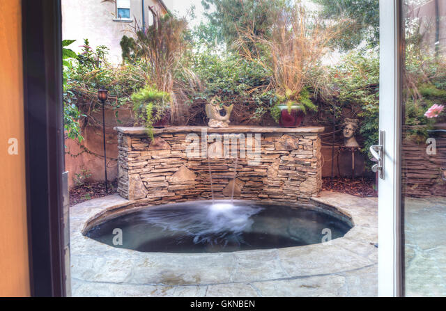 Patio garden pond stock photos patio garden pond stock for Oval garden tub