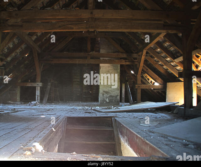 Stairs To The Old Forgotten Garret With Wooden Roof. The Forgotten Attic.    Stock