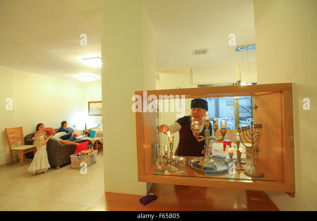 Religious Jewish woman lights Shabbat candles in her home   Stock ImageJewish Woman Stock Photos   Jewish Woman Stock Images   Alamy. Shabbat Candle Lighting Miami. Home Design Ideas