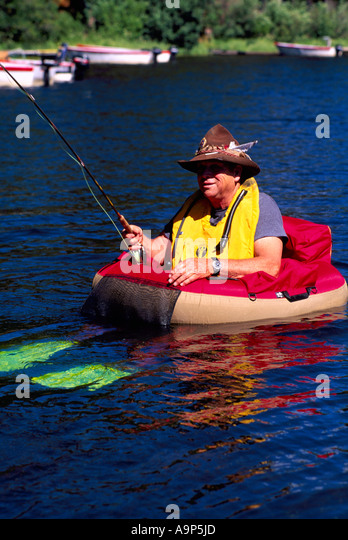 Float tube fishing stock photos float tube fishing stock for Belly boat fishing