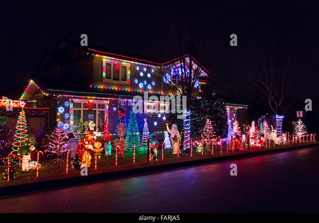 Coloured lights home stock photos coloured lights home stock display of christmas lights and cartoon characters at a home in greater vancouver outdoor holiday mozeypictures Choice Image