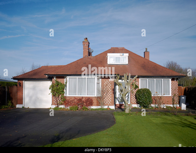 Garage Bungalow Part - 46: Bungalow With Garage And Chopped Tree UK - Stock Image